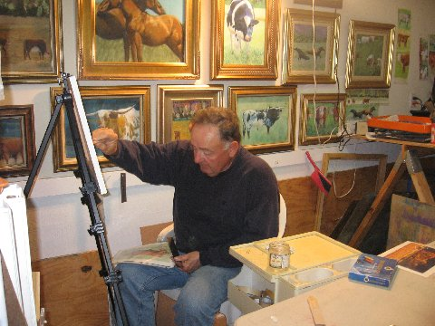 Floyd Day at work on his cow and horse pastels